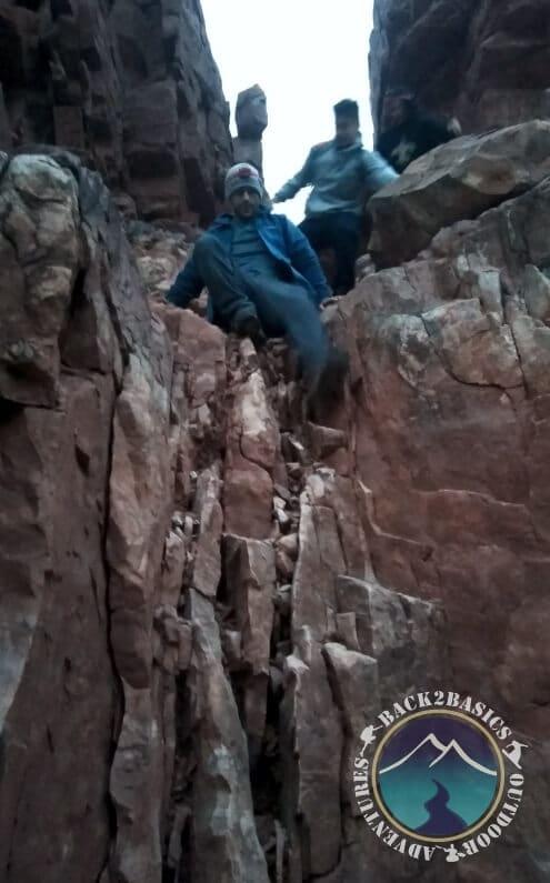 Young Men Grand View Climbing Down
