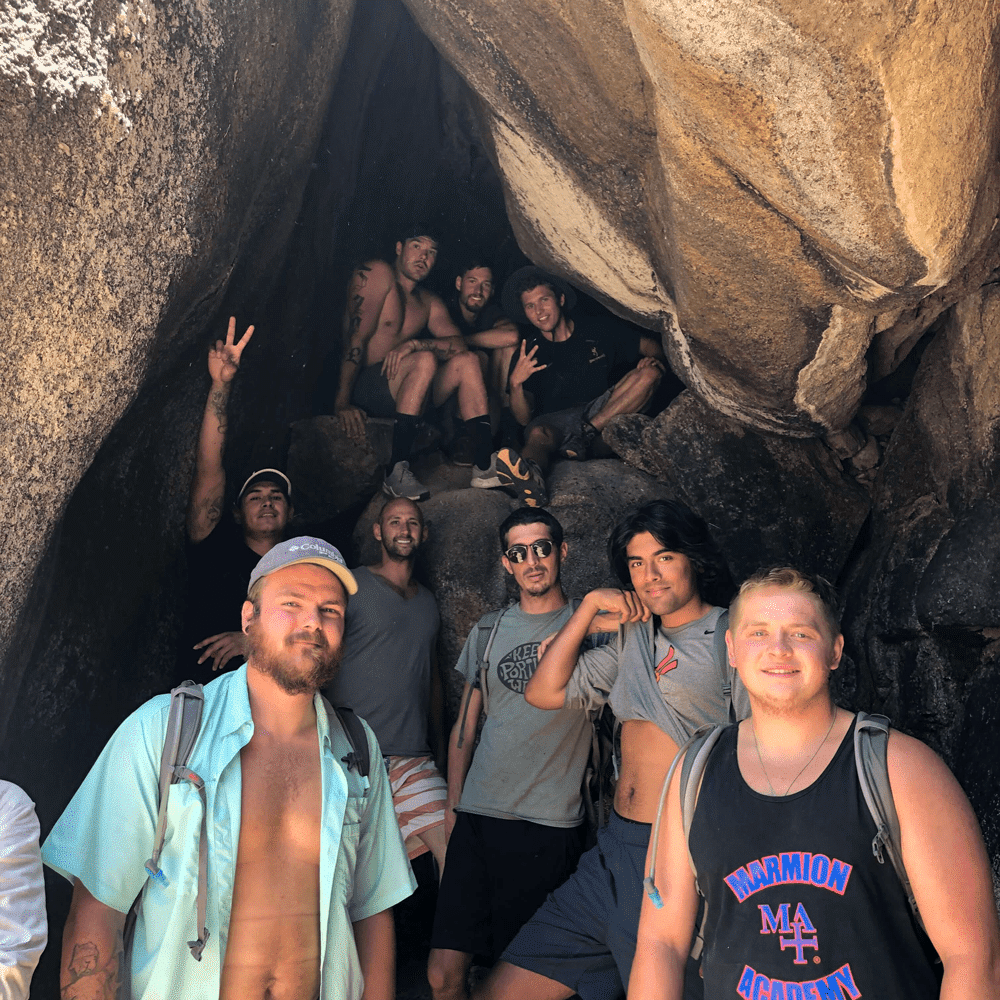 Young Men Coming out of Cave