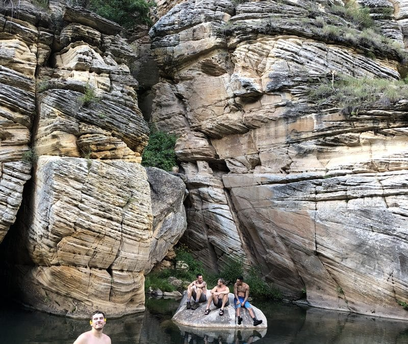 Young Men on Rock in River