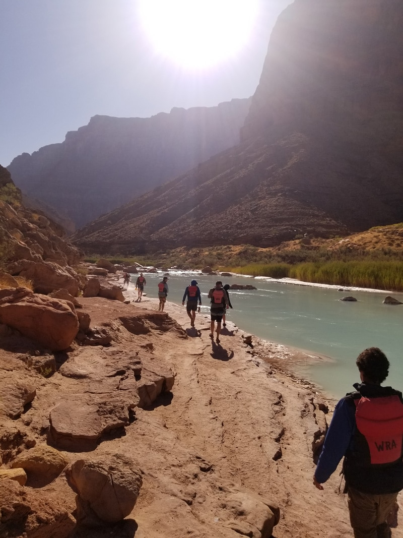 Young Men Hiking Along River